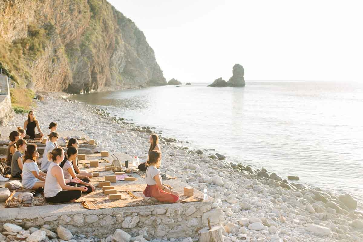 yoga meditation practice on the beach at our yoga retreat center in Montenegro, Europe