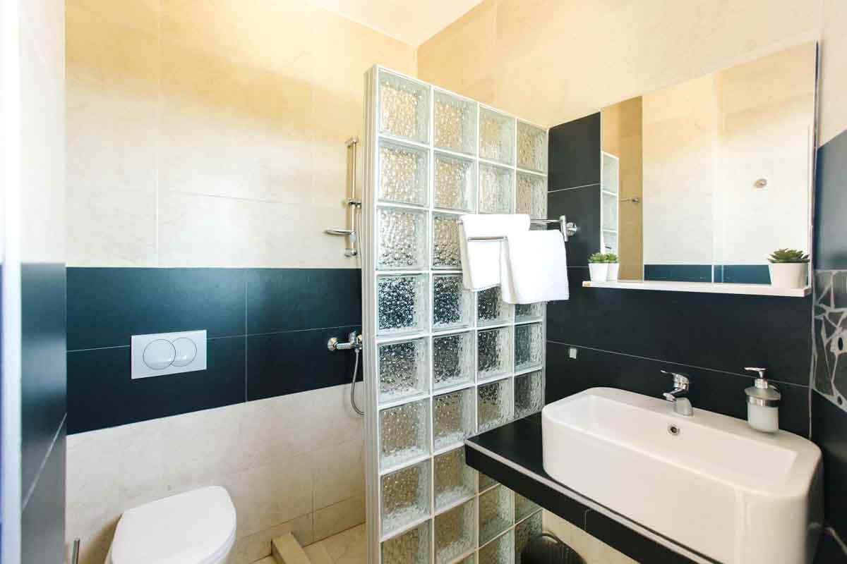 Dorm-room-shower-mahakala-center